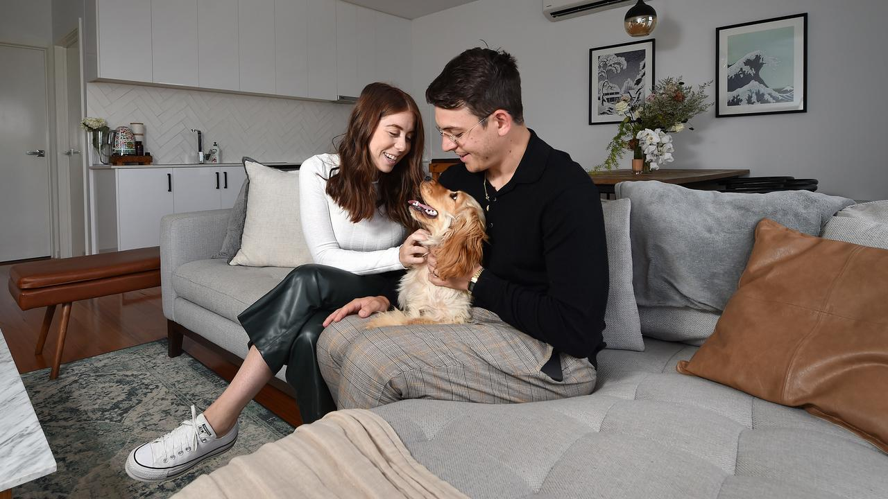 Christian and wife Jessica, plus their puppy Winnie, at their Coburg townhouse which is currently for sale. Picture: Nicki Connolly