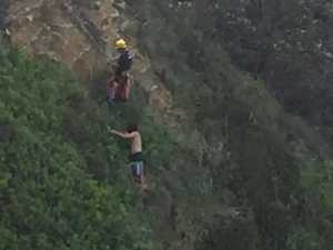 Man rescued from cliff after trying to help dog