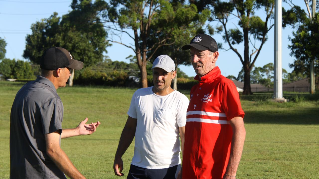 Lismore Swans AFC held their first training session for 2021 on January 12 for men's and women's teams under the aegis of new senior men's coach Ashley Pritchard (far right) and assistant coach Glenn Burns (far left), talk with former coach Joey Mitchell. Photo: Alison Paterson