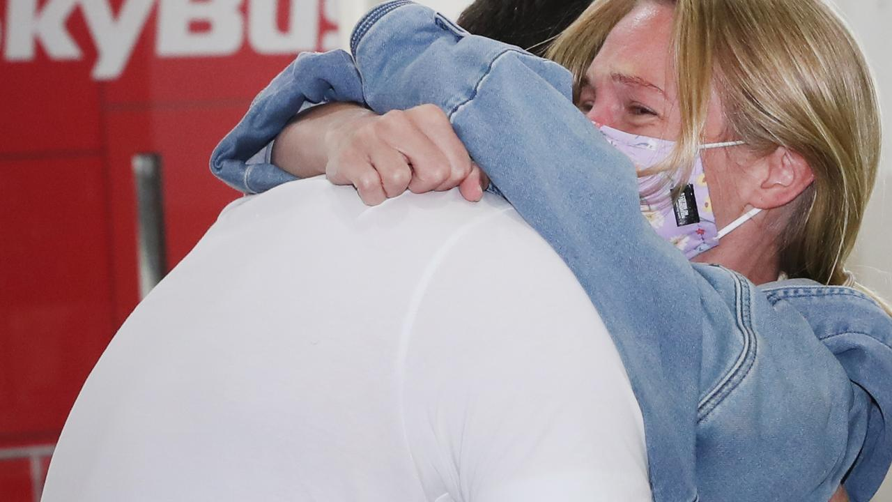 Jacki Clark and boyfriend Dan share a hug after 6 weeks apart.. Picture: David Crosling