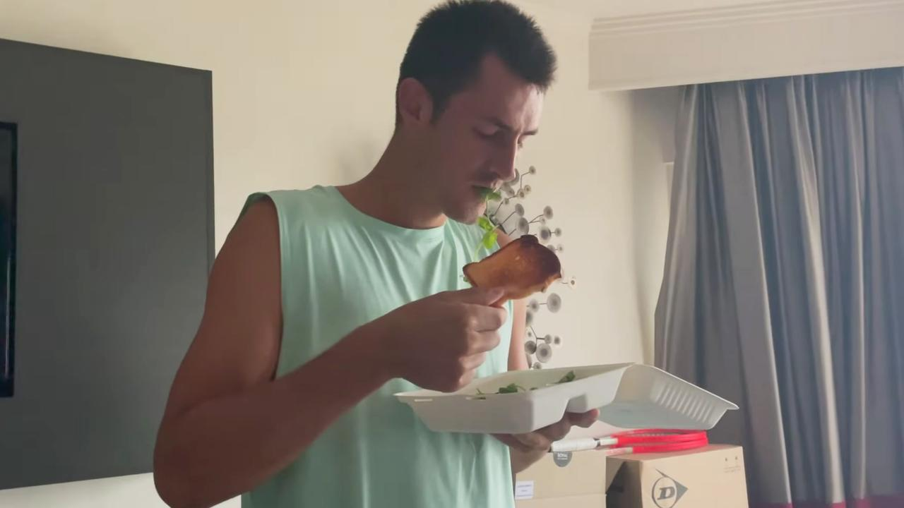 Bernard Tomic looking very unenthused about his toast.