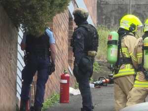 Armed police swarm NSW street
