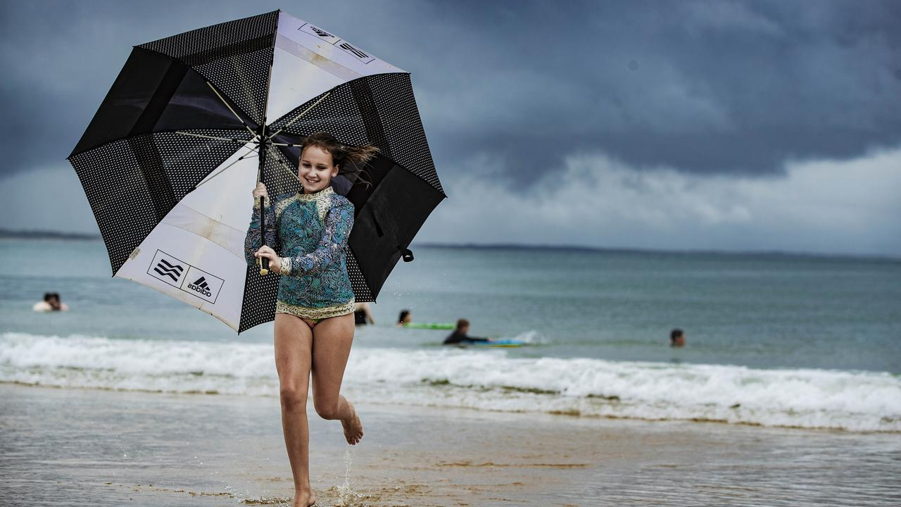 Rebekah Strong, 11, didn't let the wet weather spoil her fun on the beach while on holiday at Noosa last week. Picture: Lachie Millard