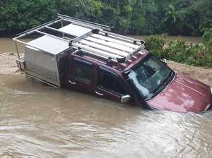 Ute submerged in flood-prone causeway