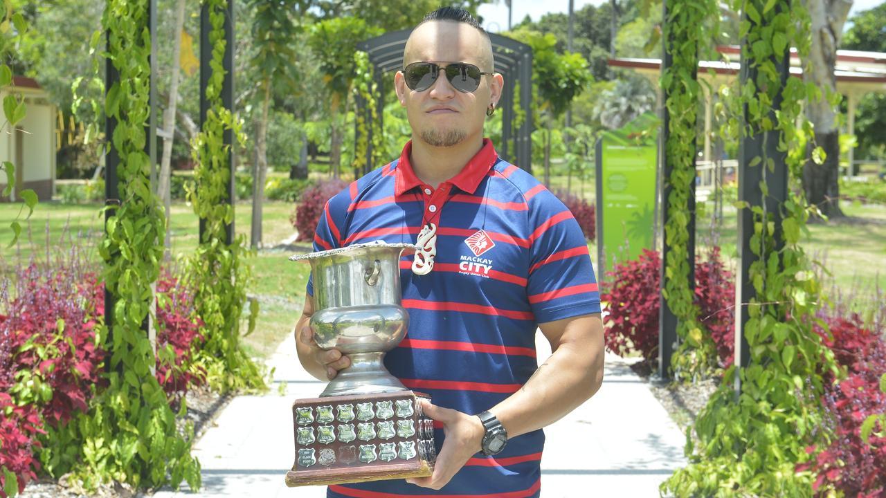 Mackay City Rugby Union vice-captain Bronson Barnett with the premiership trophy. Photo: Callum Dick