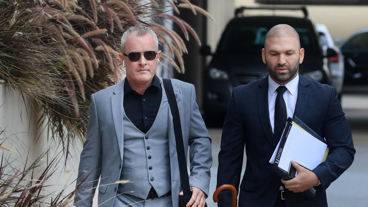 Jayden Moorea (left) arrives with his legal team for day 3 of the committal hearing at Southport Magistrates Court. Photo: Scott Powick.