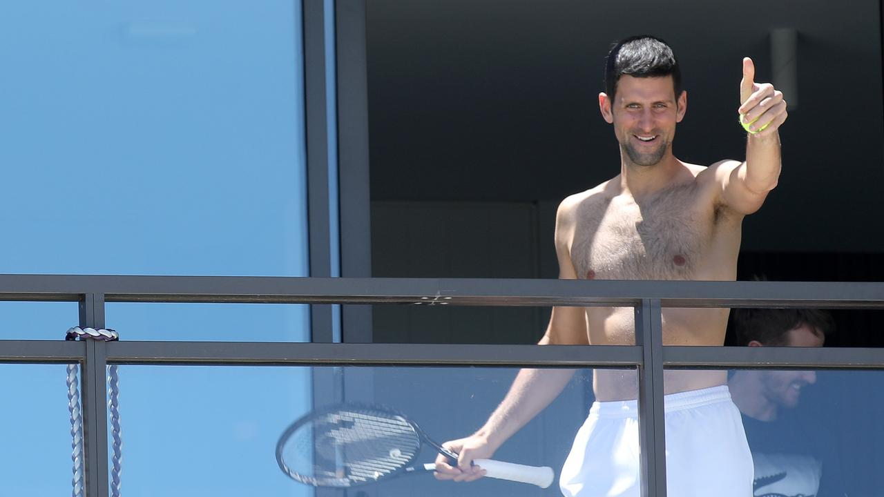 Shirtless and smiling from his balcony, Novak Djokovic appeared in good spirits from quarantine despite his Open demands being knocked back.