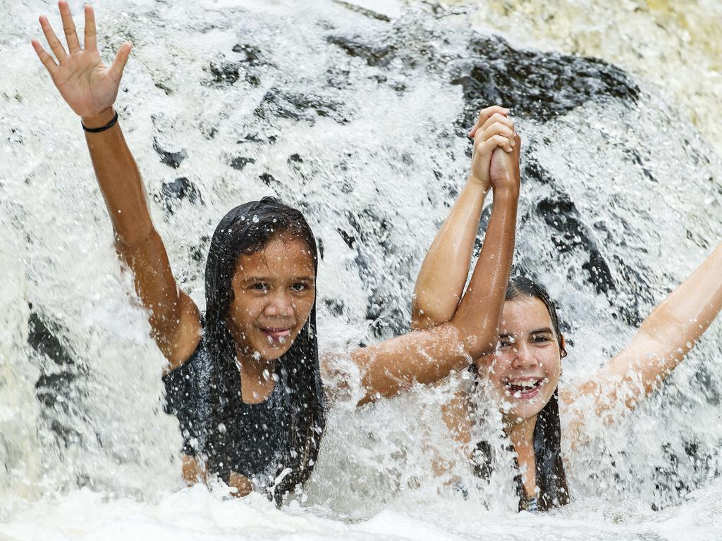 Friends Eva Thiele and Mia Zaremba, both 11, cool off at Gardiners Falls as February's heavy rainfall fills the hinterland waterfalls. Photo Lachie Millard