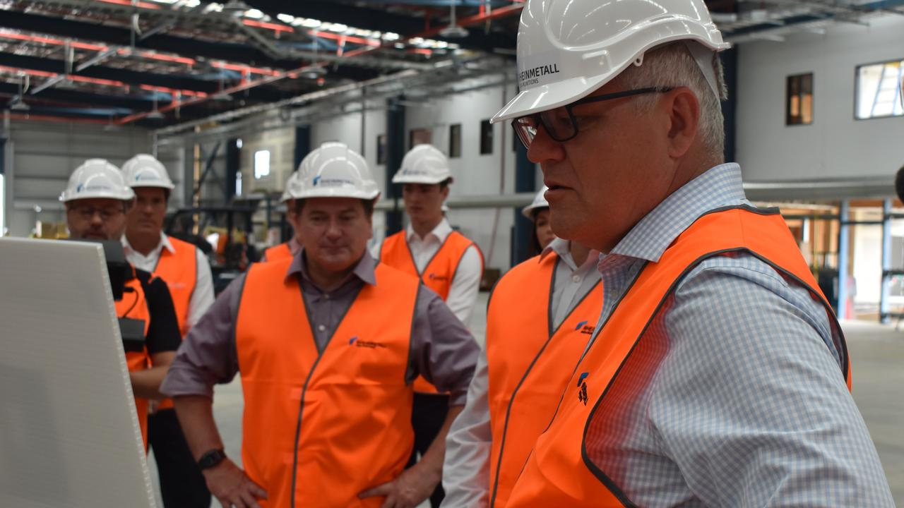 Prime Minister Scott Morrison inspects concepts of the Rheinmetall Nioa Munitions factory with MP Llew O'Brien. Photo: Stuart Fast
