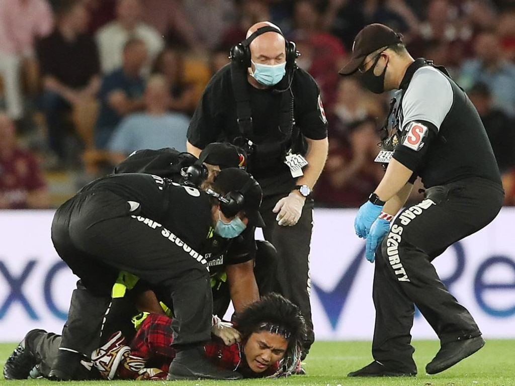 Johnson Wen is detained by security at Origin III. Picture: Peter Wallis