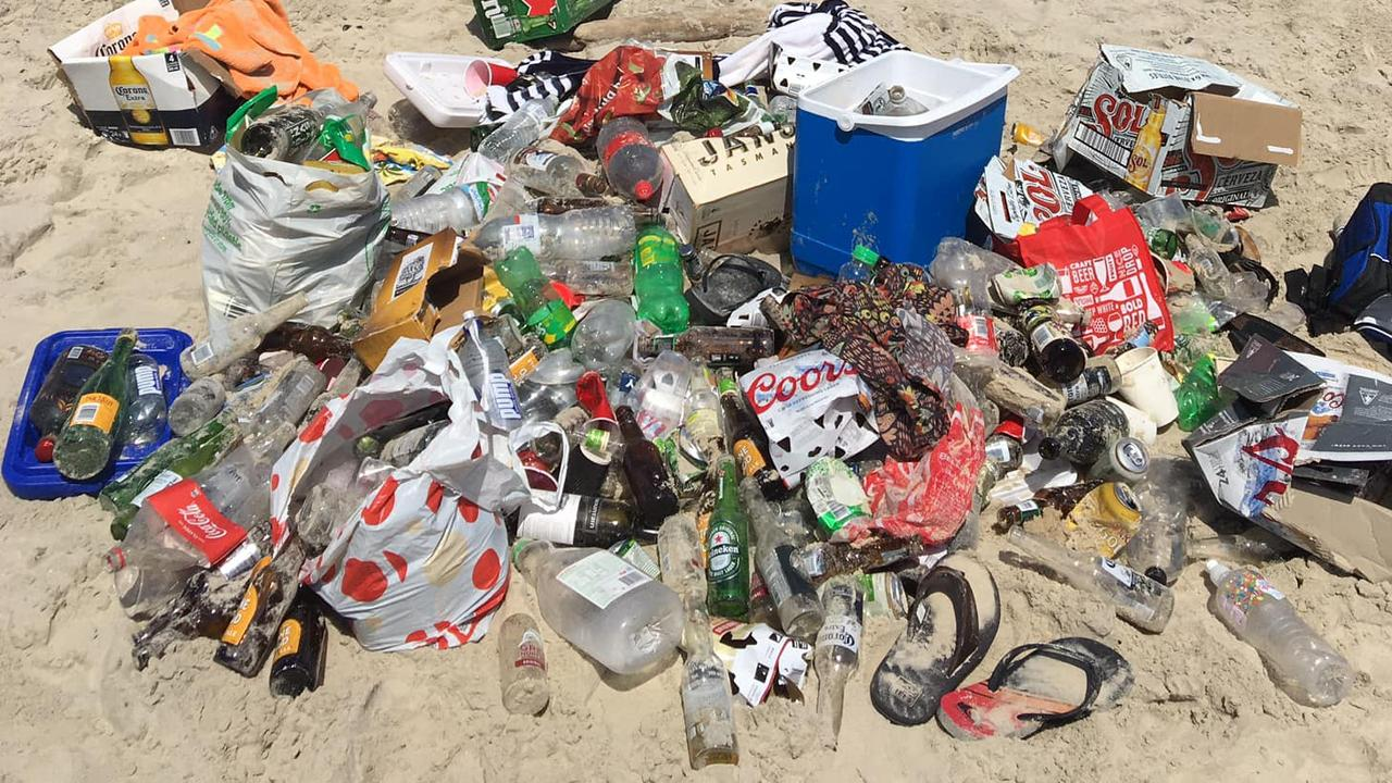 About 200 backpackers were allegedly gathered at an illegal beach party in Byron Bay last month. Pictured is a pile of rubbish left at Belongil Beach following the Boxing Day party. Picture: Supplied
