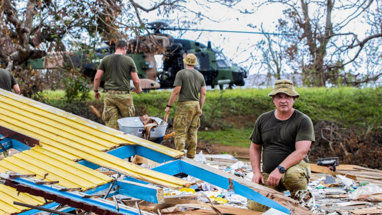 Australian Army soldier, Corporal Stuart Somerville, looks over debris from the local primary school that was destroyed by Tropical Cyclone Yasa on the island of Galoa, near Vanua Levu, Fiji during Operation Fiji Assist. PICTURE: ADF/SUPPLIED.