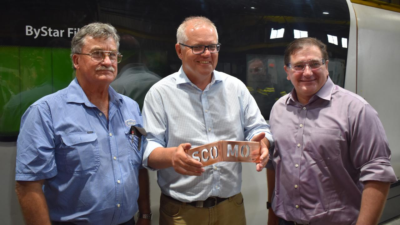 MARYBOROUGH VISIT: (L) Global Manufacturing Group Director of Business Development, Phil Dowling, Prime Minister Scott Morrison and MP Llew O'Brien. Mr Dowling presented the Prime Minister with a laser cut name plate bearing,