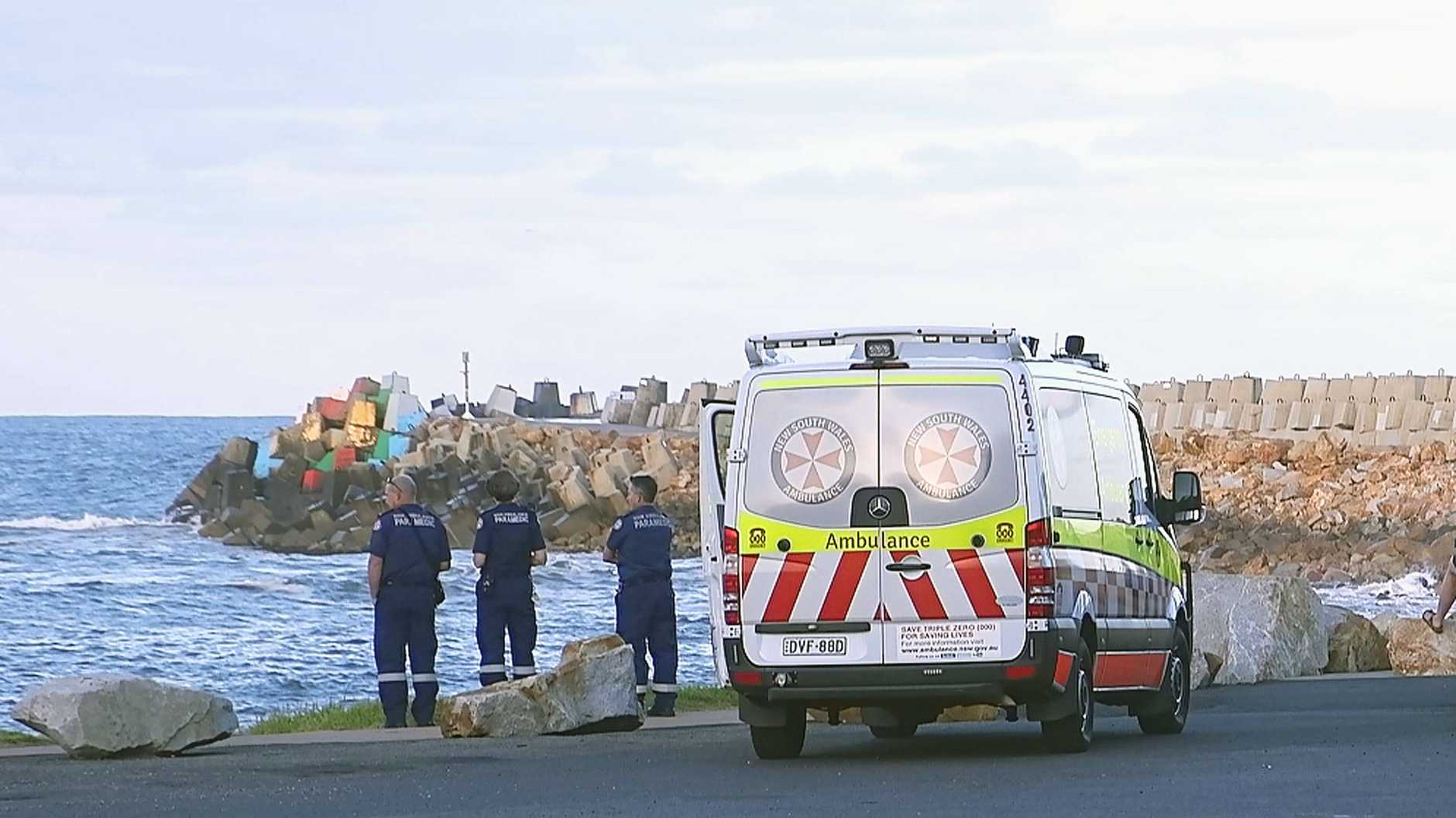Authorities search for man washed off the southern breakwall at Coffs Harbour. Photo by Frank Redward