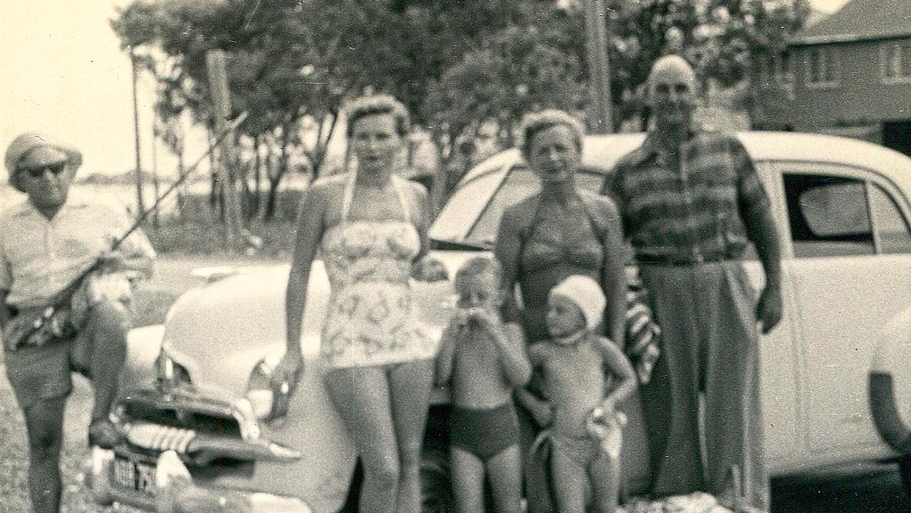 Spies on holiday: Vladimir Petrov with the fishing rod, Joan Doherty, Mark Doherty, Evdokia Petrov with Sue-Ellen Doherty, and an unidentified ASIO agent. Picture: Supplied