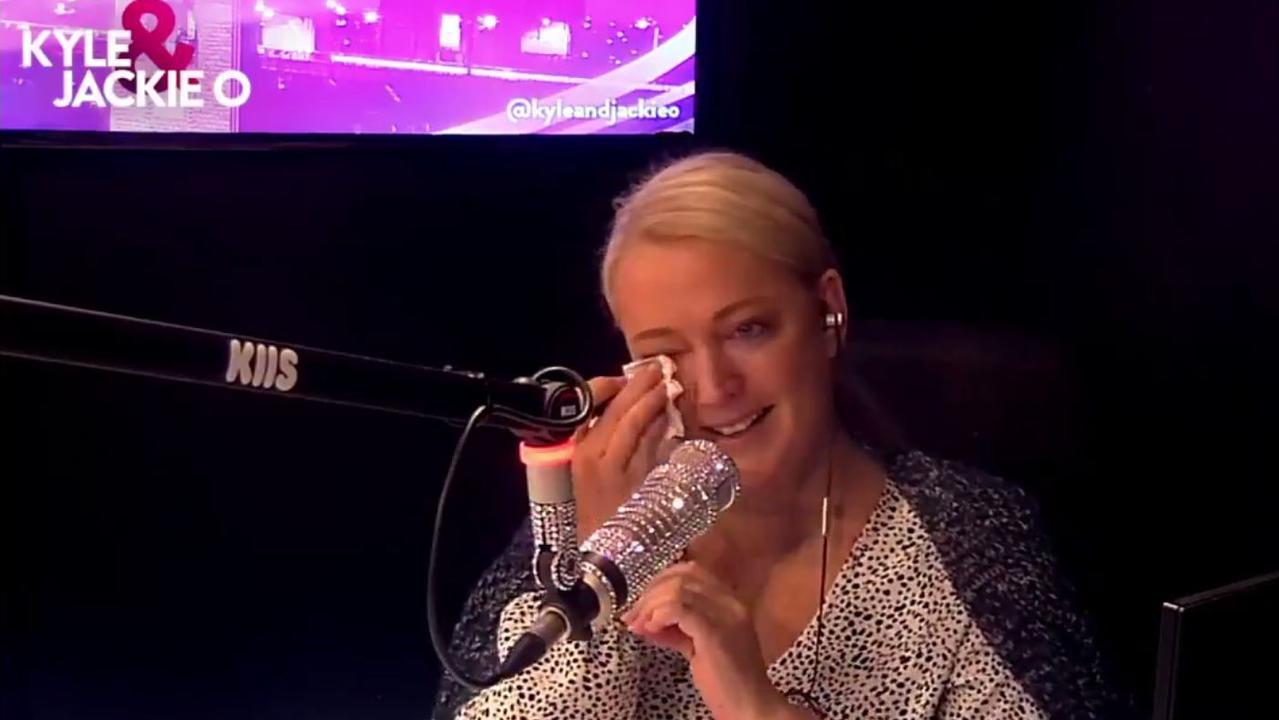 The radio star broke down on air this morning after hearing a fake obituary about her longtime co-host, Kyle Sandilands.