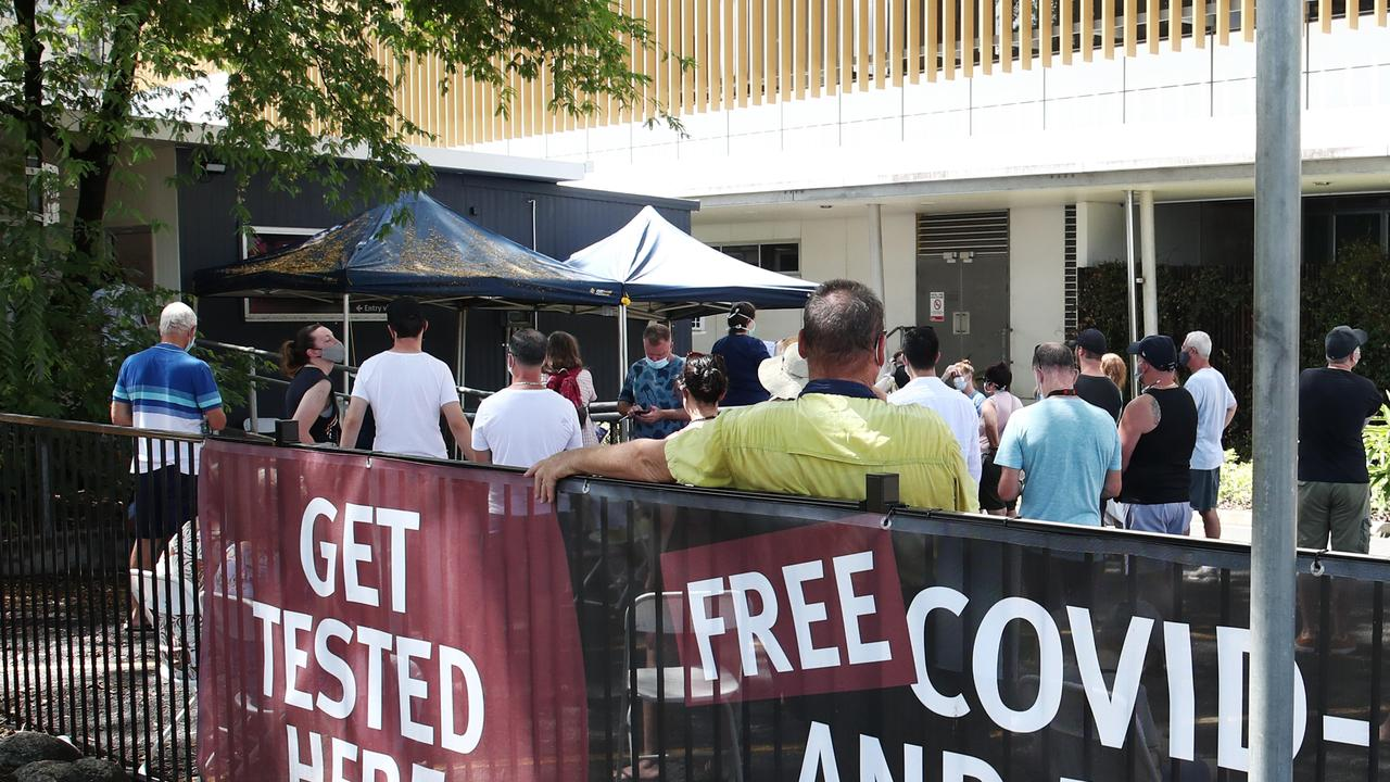 A line of people forms at the Cairns Hospital fever clinic for COVID-19. PICTURE: Brendan Radke