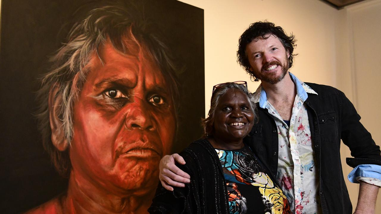 Aboriginal Elder Daisy Tjuparntarri Ward (left) and artist David Darcy pose for a photograph in front of David's portrait of Daisy which won the 2019 Archibald People's Choice award. It is one of the many paintings on display in Coffs Harbour from Saturday. (AAP Image/Bianca De Marchi)