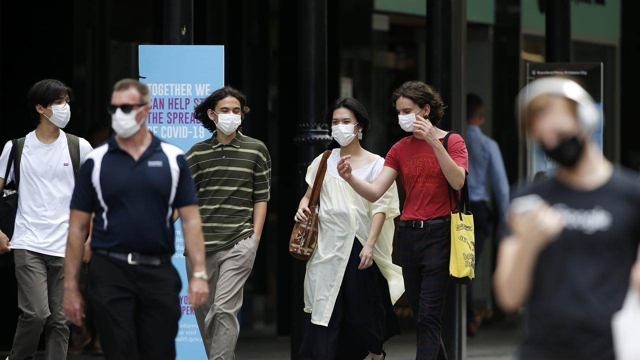 People pictured wearing masks in the Brisbane CBD\1. This Friday people in Greater Brisbane won't have to wear masks. Picture: Image/Josh Woning
