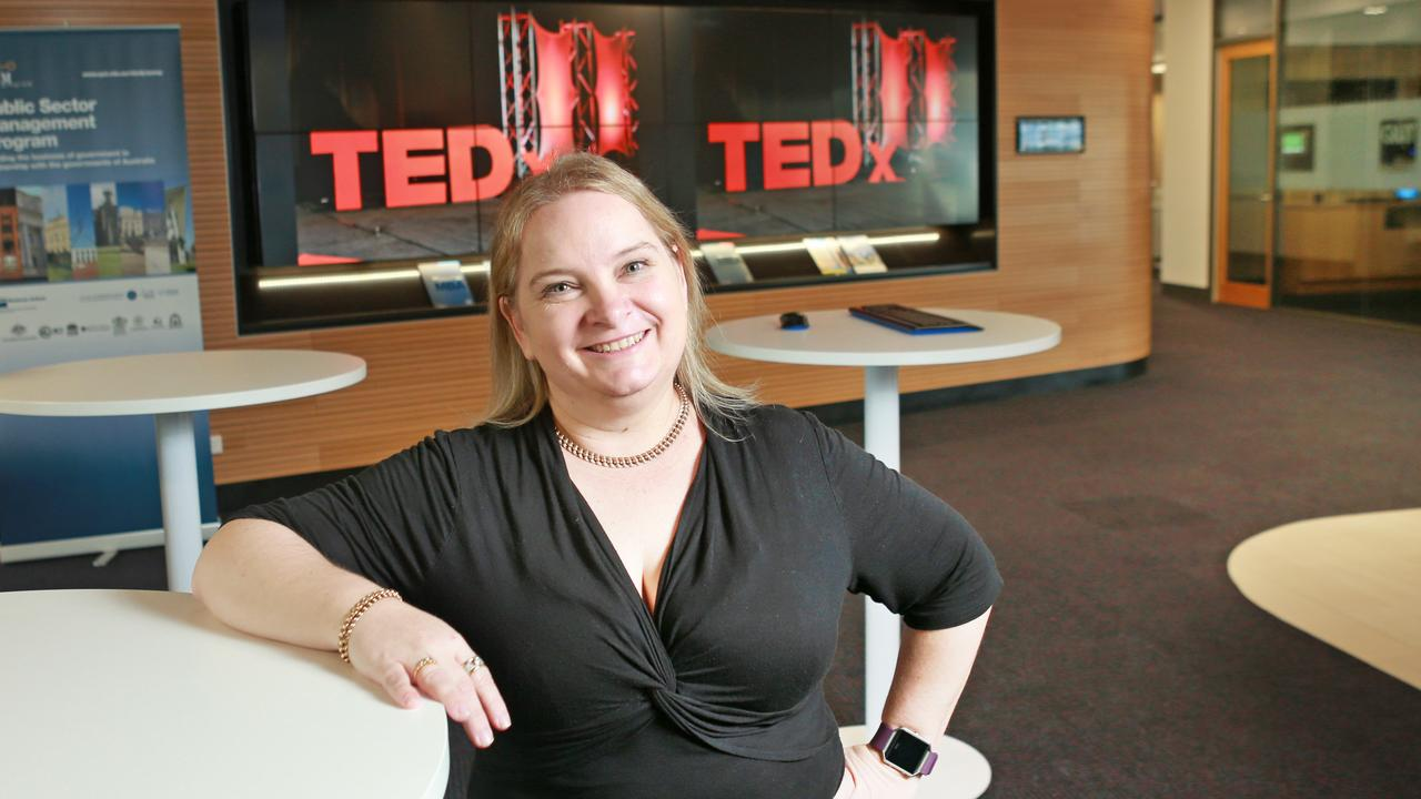 Juanita Wheeler in a class room where she is talking to and working collaboratively with a team like a mock TED talk in 2017. Photo: Tim Marsden.