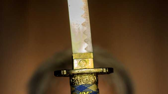 Man charged over samurai sword threats