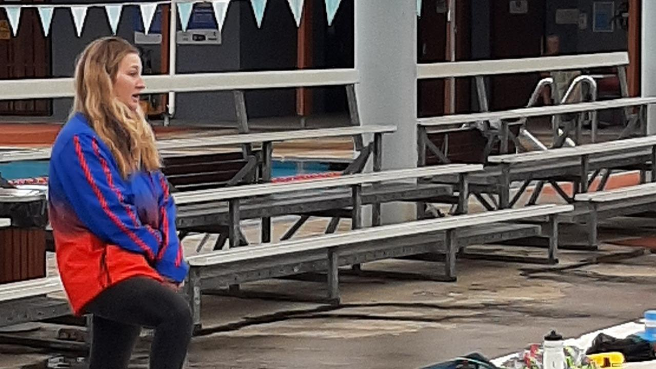 STROKE COACH: Lismore Workers Swim Team have appointed former team athlete Caitlin Diamond as their new stroke coach, who is pictured here advising Aidan Arnison and McKinley Arnison.