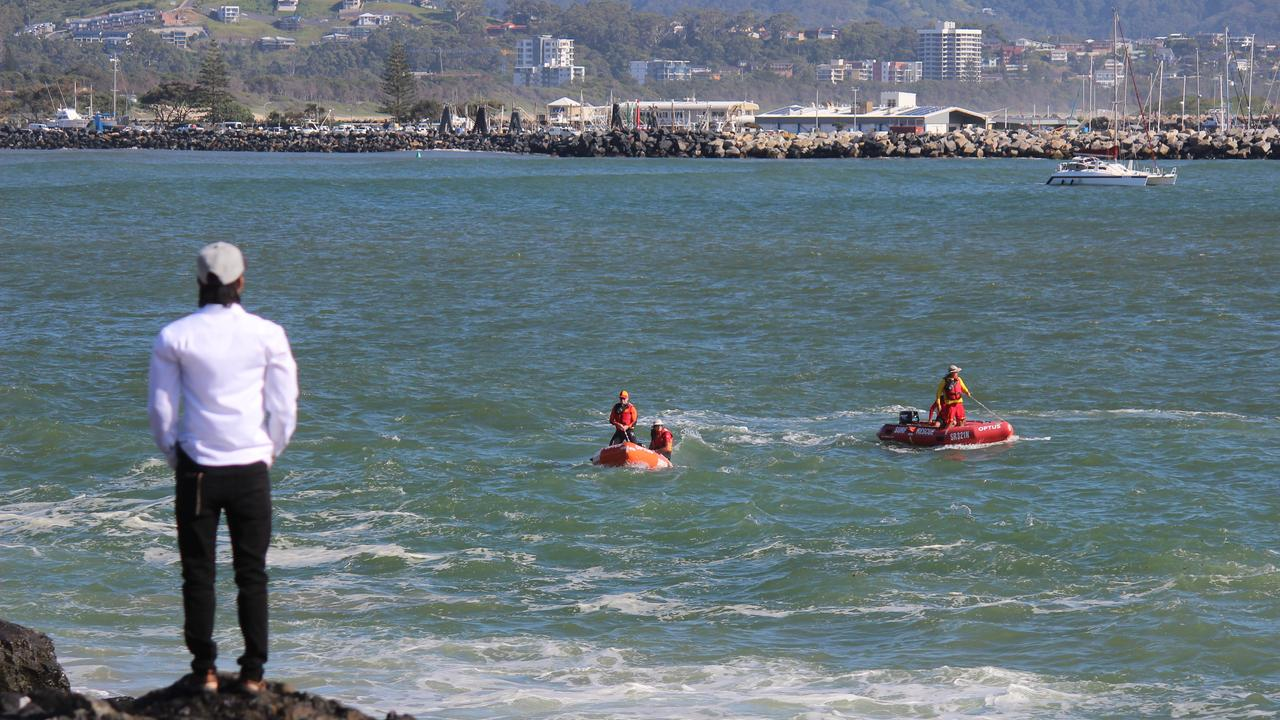 Emergency services search for a young man who was swept off the South Wall at Coffs Harbour. Photo: Tim Jarrett