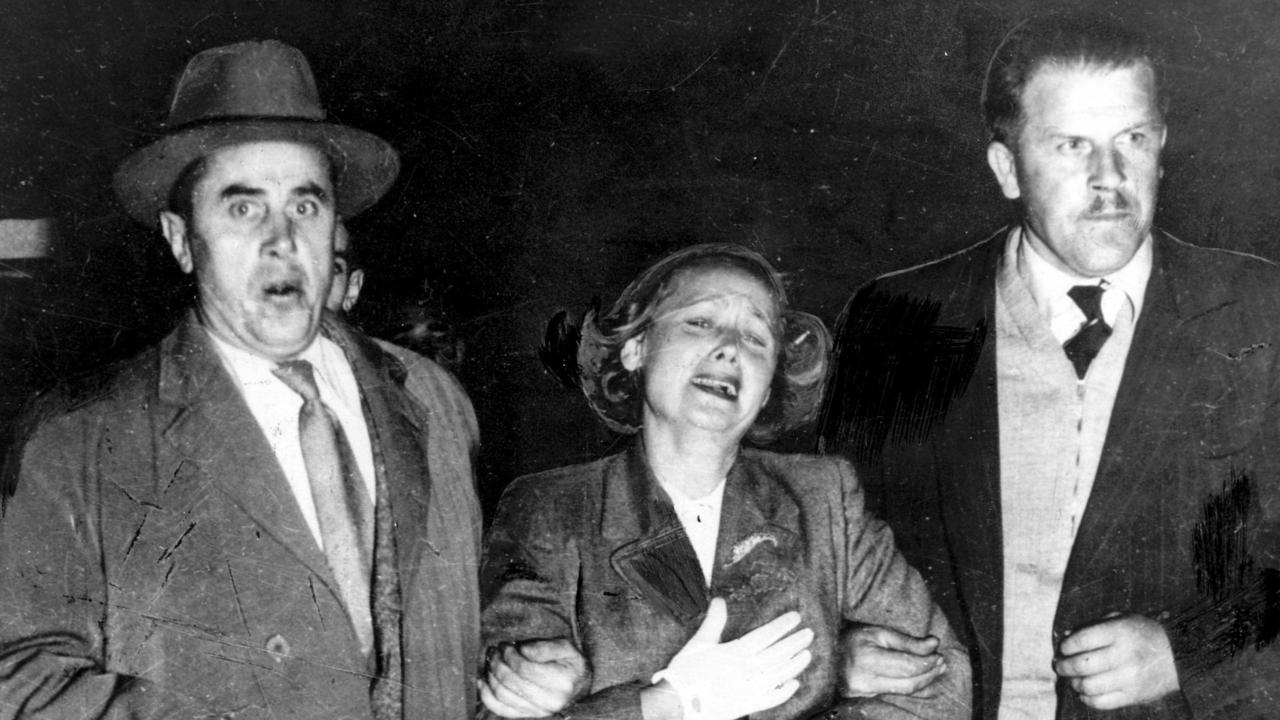 A distressed Evdokia Petrov being escorted onto a plane to Darwin, en route to the USSR, in April 1954 after her husband, Vladimir, defected. ASIO intervened at Darwin and she defected.