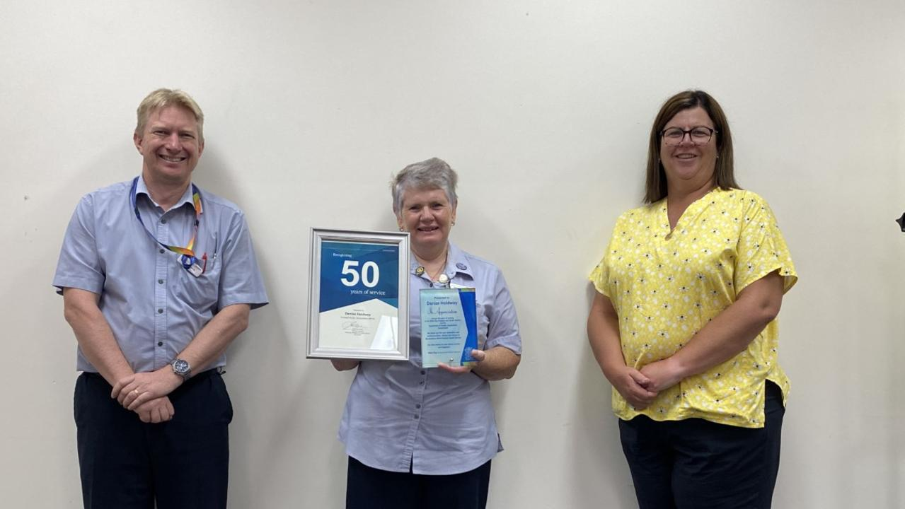 CAREER MILESTONE: Enrolled nurse Denise Holdway celebrates her 50 years of service with WBHHS Acting Director of Nursing for Rural Facilities and Services Glenn Hokin and Mundubbera MPHS Acting Director of Nursing Michelle Warren.