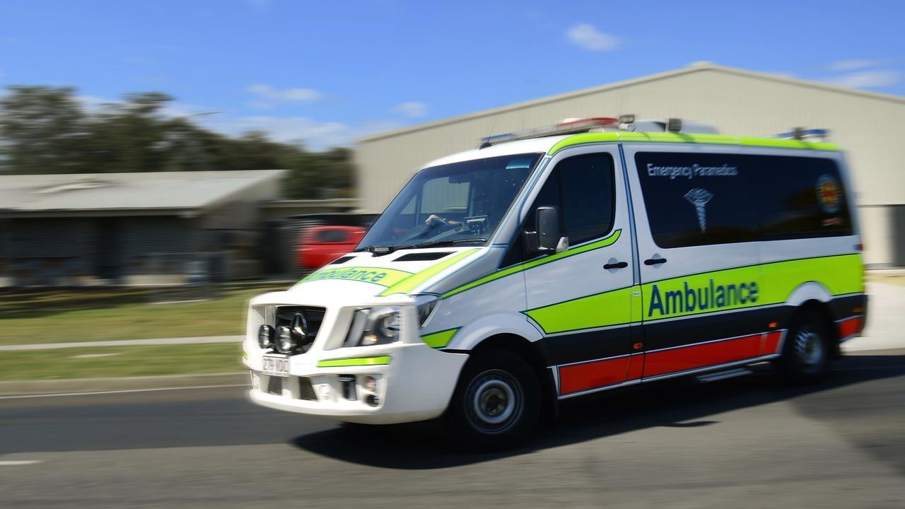 Paramedics assessed a patient after a crash.