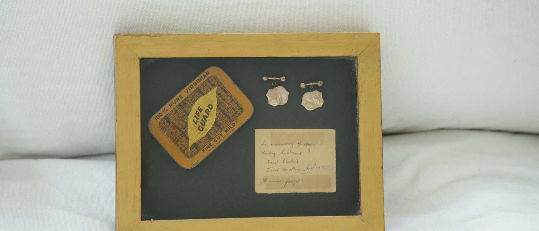 Grandfather's tobacco pouch, letter and cufflinks.