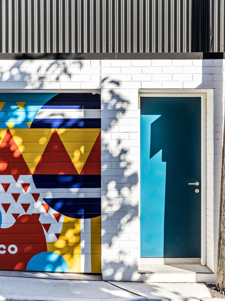 This back laneway entrance in transformed by a bold, beautiful artwork by Nico Nicoson Picture: The Palm Co
