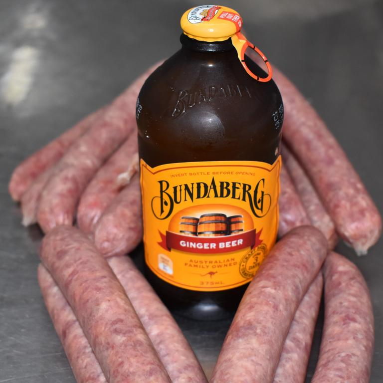 The mouth-watering lamb sausages are soaked in Bundaberg Brewed Drinks' ginger beer for 24 hours. Picture: Rhylea Millar.