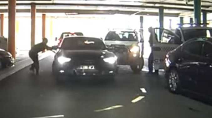Audi's carpark carnage: Cop almost hit, cars smashed