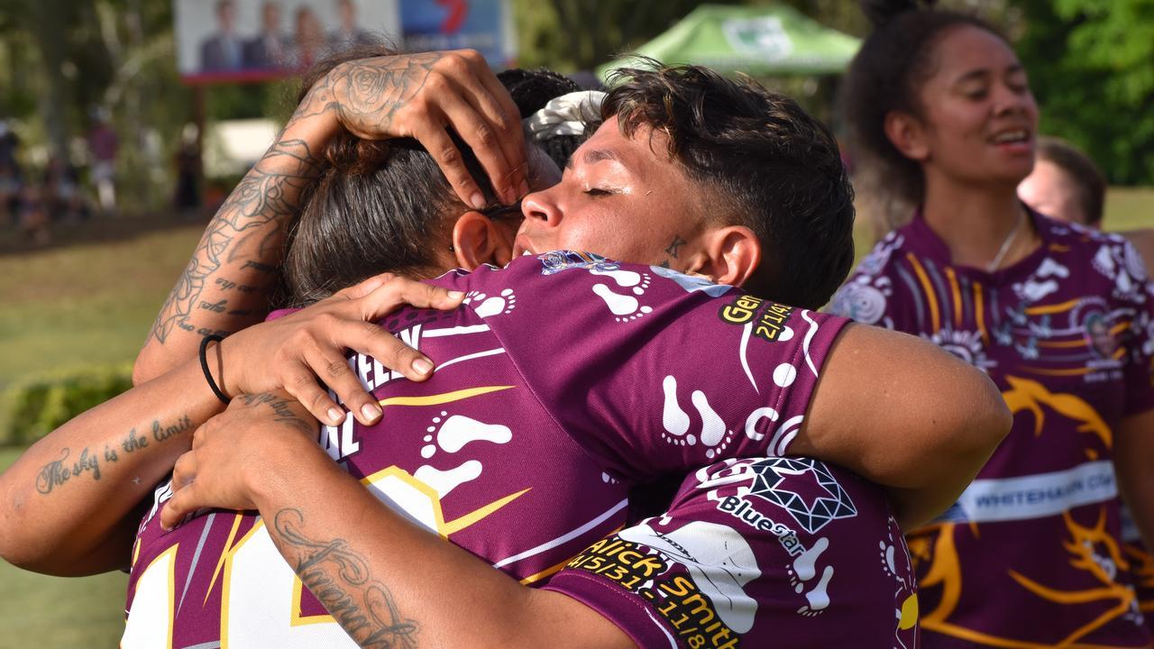 Melanie Kielly embraces player Courtney Robinson after the Mona Baraba Kielly Memorial Team's win at the Warba Wangarunya Rugby League Carnival. Pam McKay