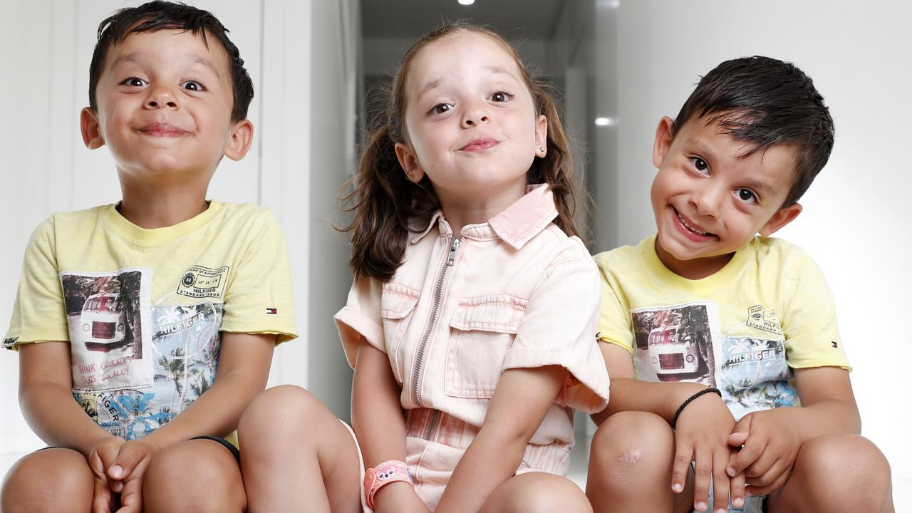 Triplets Alexia, Luis, and Tristan Georgas, 5, who are about to start school. Picture: Jonathan Ng