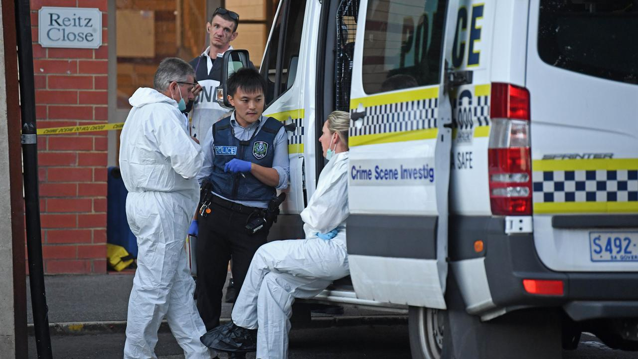 Police at the scene after a man's body was found in an apartment building on Sturt Street. Picture: Tom Huntley