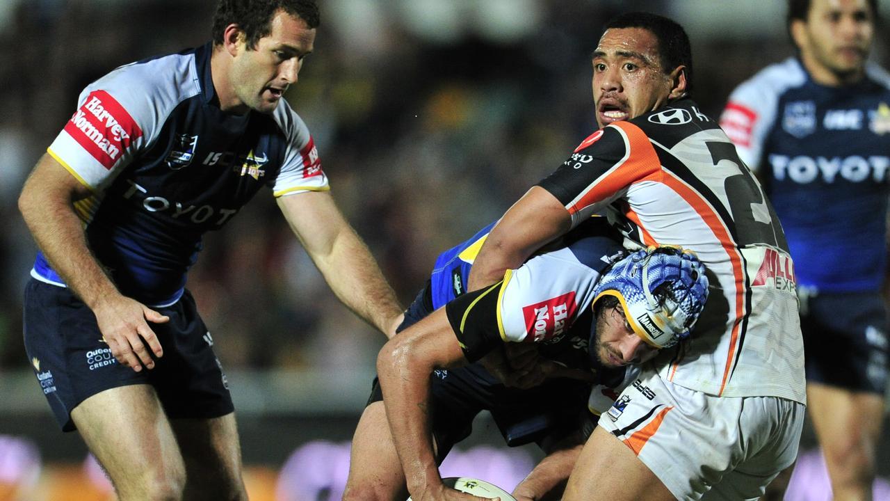 The North Queensland Cowboys vs. Wests Tigers at Dairy Farmers Stadium. Cowboys' Johnathan Thurston and Tigers' 22 Masada Iosefa