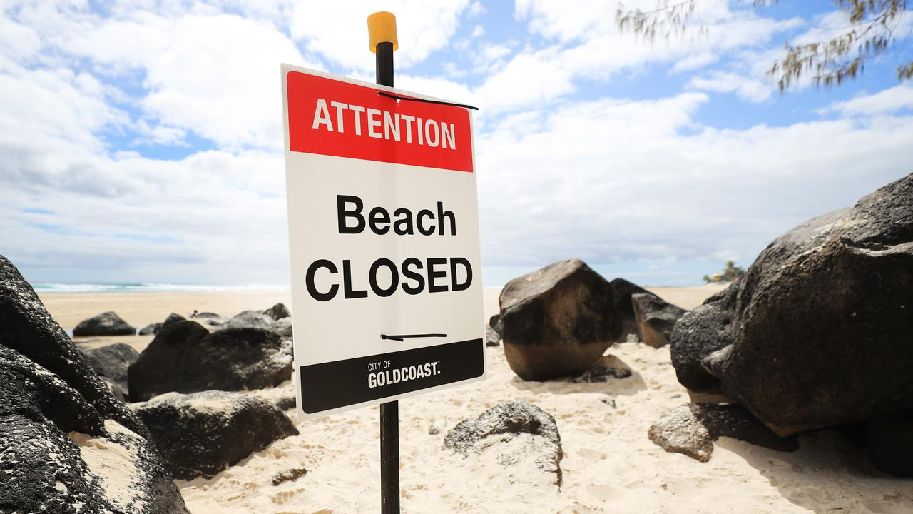 A beach closed signs at the scene of a fatal shark attack at Greenmount, Coolangatta