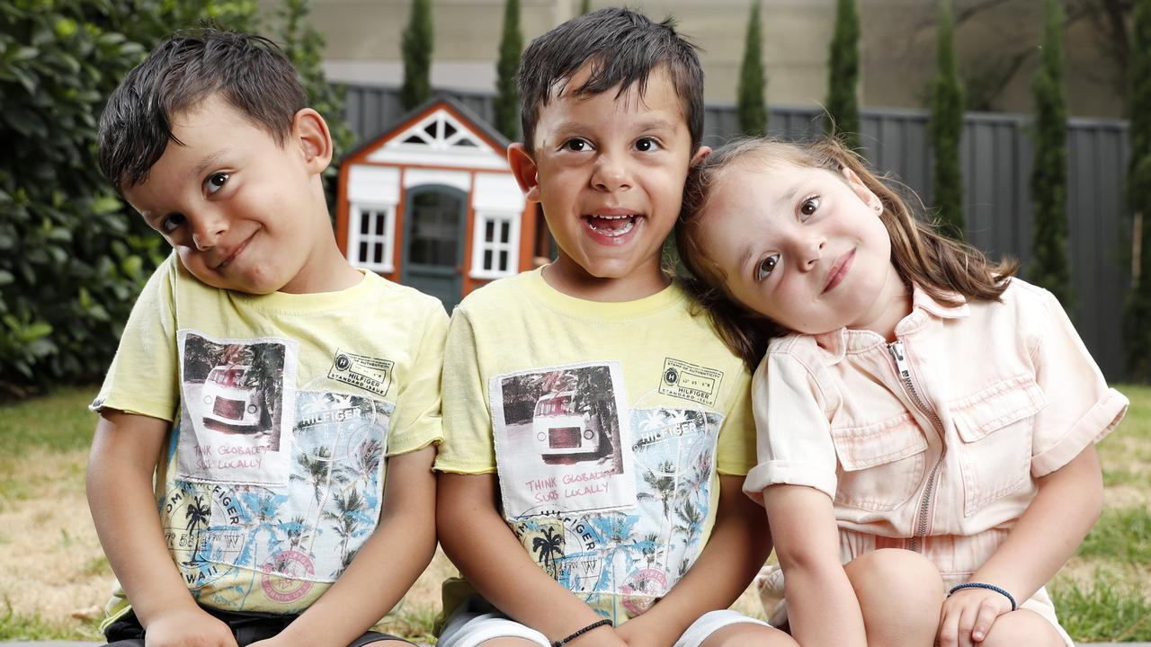 "Triplets Alexia, Luis, and Tristan Georgas hear their dad calling someone ""bro"" on the phone. Picture: Jonathan Ng"