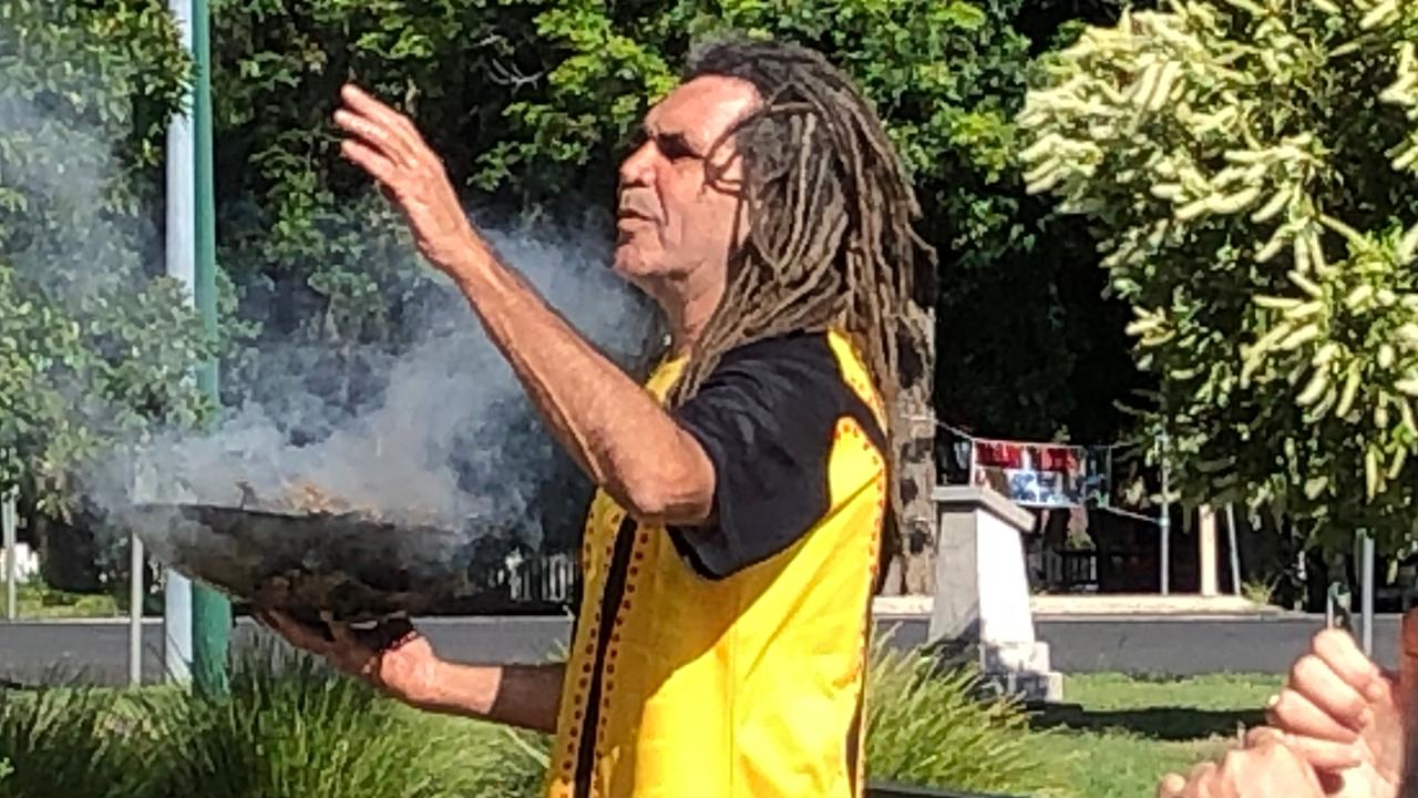 SMOKING CEREMONY: At Lismore Town Hall Gilbert Laurie was watched by people who attended his smoking ceremony while Belinda Roberts provided an AUSLAN translation, ahead of the Australia Day Awards and Citizenship Ceremony. Photo: Alison Paterson