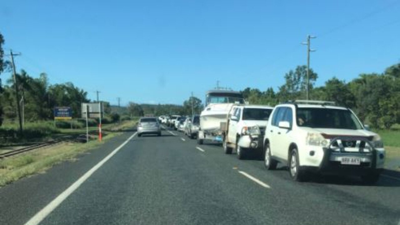 Cars are banked up on Shute Harbour Rd after a three-vehicle crash outside Plants Whitsunday. Photo: Elyse Wurm