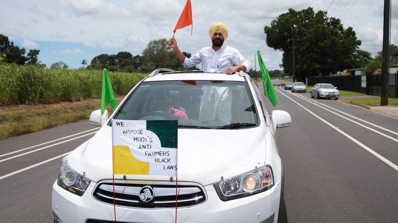 Mena Creek farmer Pritpal Singh holds a flag in support of Indian farmers at a rally in Innisfail which saw more than 200 Far Northern Sikhs gather at the town's King George Park. Picture: Arun Singh Mann