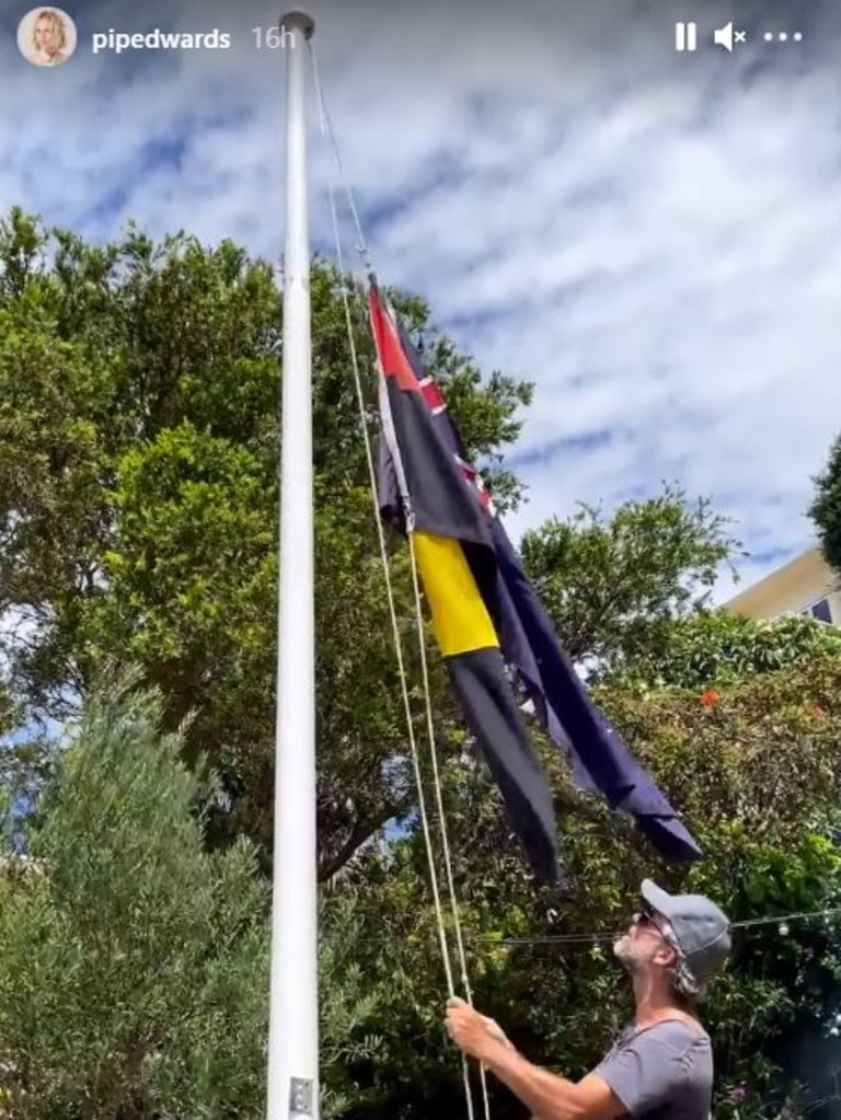 As part of her celebrations her group hung an Aboriginal flag upside down. Picture: Instagram/PipEdwards