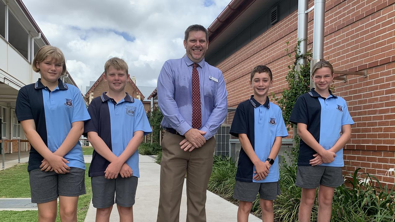 (L) Lily Fraser, Ethan Neilsen, Deputy Principal Damian Blyth, Daniel Clayton and Tarlia Daevies on the first day of school, 2021. Photo: Stuart Fast