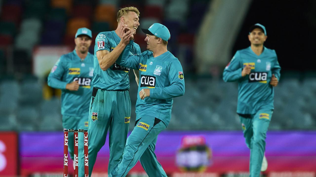 Brisbane Heat debutant Jack Wood takes the wicket of Melbourne Stars batsman Ben Dunk in Canberra. Picture: Brett Hemmings/Getty Images