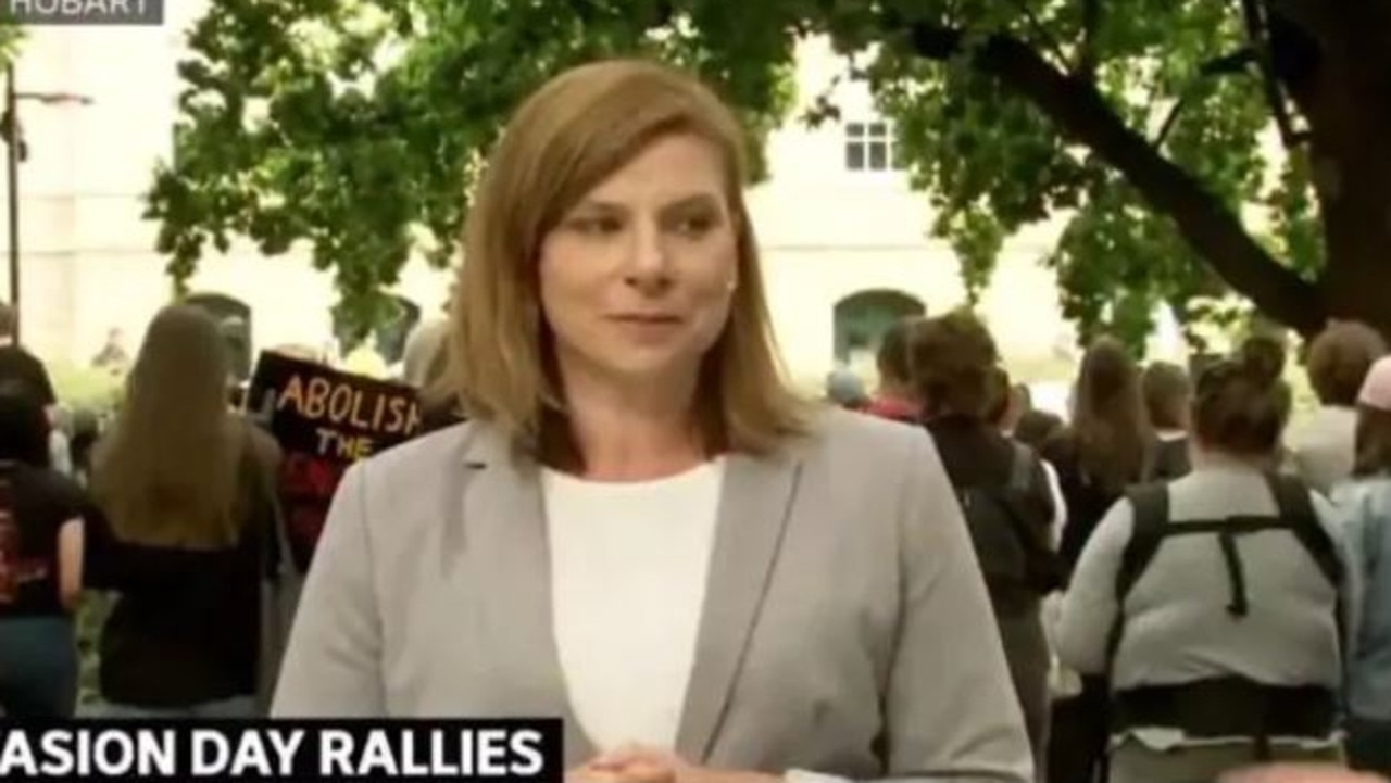 ABC Hobart reporter Edith Bevin was told off for interrupting a minute's silence at an Invasion Day rally.