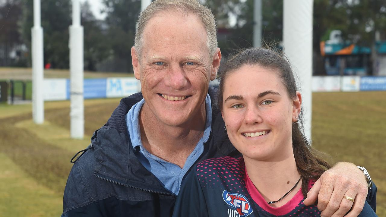 Nathan Burke with daughter Alice, when she was a 16-year-old AFLW prospect. Picture: Josie Hayden