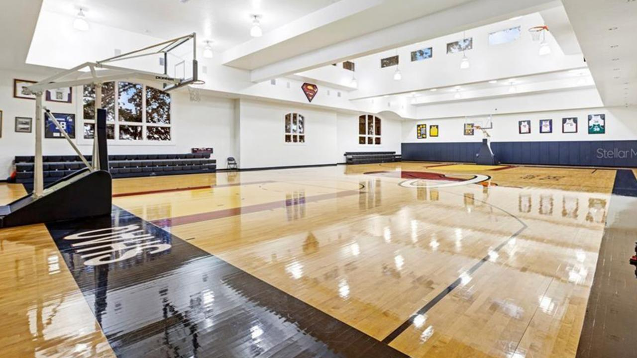 There's a huge basketball court inside the home. Picture: Realtor