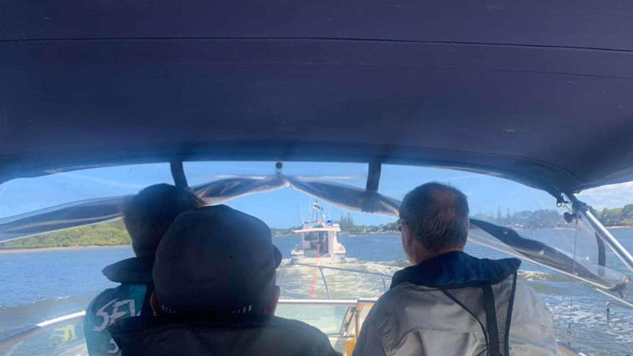 A Bayliner is towed back to Yamba Marina by Yamba Marine Rescue. The boat owners have praised the swift action of the rescue service after they ran into engine trouble 8km off Yamba.